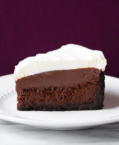 This luxurious pie is layered with an Oreo crust, flourless cake, creamy chocolate pudding, and whipped cream. Get the recipe from Cooking Classy.