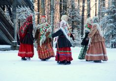 Russian ladies in traditional costumes and bright shawls are dancing at one of the folk festivals.