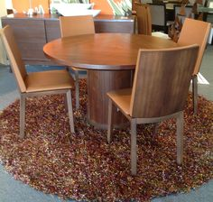 Walnut Dining Table with Flex-Back Leather Dining Chairs, Available at Scanhome Furnishings in Green Bay