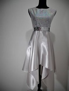 Its a Beautiful Worship Dance Top. for dance ministries. Product Description: Style: hankie dress top - Sleeveless Fabric: HOLOGRAPIC SEQUIN ,and Satin for the skirt. Color: SILVER. The dress come with a sequin liturgical cummerbund belt that adds a band of sparkle to your