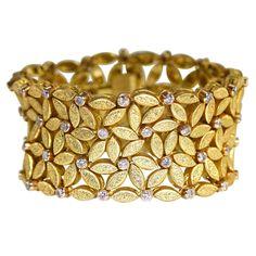Buccellati Diamond Gold Wide Link Bracelet   From a unique collection of vintage link bracelets at https://www.1stdibs.com/jewelry/bracelets/link-bracelets/
