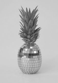 Disco Pineapple.  I don't know where this came from or why it exists but let me tell you something.  This badass little pineapple would have a place of GLORY on my coffee table.