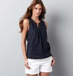 Ann Taylor classic.  I like the navy top and cutout neckline.