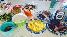 BOOM look at that spread!!!!! Santa Maria Style Tri-tip Costco St. Louis style ribs pineapples salad Ranch style beans Apple Sausages and Chips n Dip for appetizer.