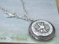 Compass locket necklace...how sick is that?
