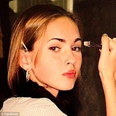 Poised and polished: A 12-year-old Megan Fox combs her eyebrows with a toothbrush in a cute snap the actress has posted on her Facebook page