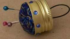 Pin cushion made from metal bottle cap.