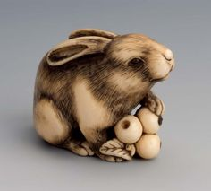 Okatomo of Kyoto, Hare and Biwa, late 18th to early 19th century, Stained ivory and horn, 3.1 x 3.9 x 2.1 cm