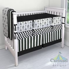 Crib bedding in Black Deck Stripe, White and Black Arrow, Solid Black, Black and White Zig Zag. Created using the Nursery Designer® by Carousel Designs where you mix and match from hundreds of fabrics to create your own unique baby bedding. #carouseldesigns