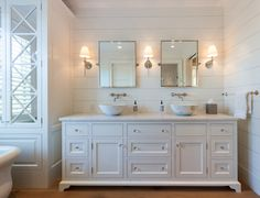 Shiplap bathroom with double sinks.