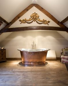 Gorgeous Country Chic interior featuring William Hollands Copper Bateau bath.