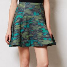 "NWOT Nanette Lepore Quilted Camo Skirt With a focus on bold colors and evocative prints, Nanette Lepore's eponymous line is inspired by her bohemian childhood in Ohio, her passion for throwing a good party, and the excitement of her adopted hometown of New York City. Her sculpted silhouettes skew a bit retro, but feel at home in any era. Case in point: this kicky quilted skirt. By Nanette Lepore Back zip Polyester, spandex; acetate lining Dry clean 17.75""L Nanette Lepore Skirts Mini"