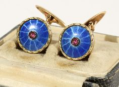 A PAIR OF FABERGE GOLD AND GUILLOCHE ENAMEL CUFFLINKS, 1908-1917