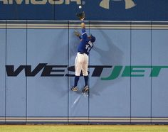 The photo of the night. Toronto Blue Jays left fielder, Rajai Davis scales the 10 foot wall at Rogers Centre Rogers Centre, Toronto Blue Jays, Sports Pictures, Mlb, Athlete, Sporty, Seasons, Baseball, Running