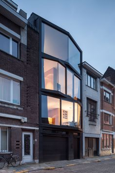 Windows angle out from this family home in Ghent, designed by Belgian architects Steven Vandenborre and Mias Sys to give multiple perspectives on the city