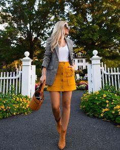 Warm up your plaid classics with a mustard mini and cognac chic details a la Lori Murphy Mustard Yellow Outfit, Mustard Yellow Skirts, Yellow Mini Skirt, Mustard Skirt, Yellow Skirt Outfits, Winter Skirt Outfit, Fall Skirts, Cute Skirts, Mini Skirts