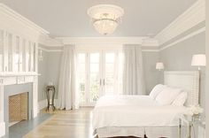 all white bedroom with crown molding