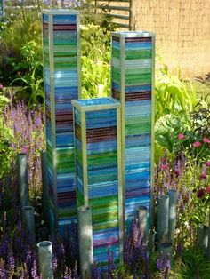 CD cases, stacked and painted with stained glass paint. The Deptford Project's Small Garden was abou Cd Case Crafts, Cd Crafts, Yard Art Crafts, Recycled Garden, Recycled Art, Garden Poles, Stained Glass Paint, Garden Ornaments, Outdoor Art
