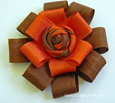 Ribbon Rose tutorial. I think I'll make some of these out of the reflective tape I have and use them as bike safety doodads!