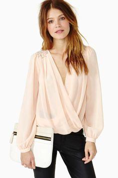 I am in love with this style of top. Loose faux wrap blouse. If I could find some to buy I'd buy 12!