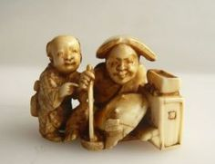 Ivory Netsuke depicting Father and Son -  A man is sitting in front of a big flounder, picking with his long chopsticks rice or vegetables out of a bowl, while a boy (his son?) standing close to him and watching curiously. The anonymous carver put many charming details into his work. Unsigned, 19th c., Width 4 cm.