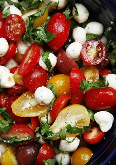 "Tomato Basil Mozzarella Salad  Ingredients:::        *1 pint cherry tomatoes, halved      *8 ounces fresh ""mini"" mozzerella pearls      *4 tablespoons olive oil      *18 basil leaves, chopped      *1/2 teaspoon Kosher salt      *1/2 teaspoon freshly ground pepper"