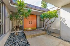 Uber-chic 1960's Los Feliz Estates Mid-Century Modern single-story home features open volume public rooms all opening with glass sliders to grassy back yard with sun decks and large new swimm…
