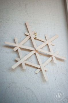 Dwell Beautiful makes some easy popsicle stick snowflakes that make for great, fun, and cheap winter decor. A great craft for kids to get in on and help out with! crafts with popsicle sticks Popsicle Stick Snowflakes - Dwell Beautiful Kids Crafts, Christmas Crafts For Kids, Diy Christmas Ornaments, Holiday Crafts, Christmas Christmas, Easy Ornaments, Spring Crafts, Easy Crafts, Christmas Leaves