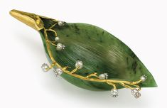A rare and important jewelled and gold-mounted nephrite study of a lily of the valley leaf. By Fabergé, circa 1900, scratched inventory number indistinct. 5½ in. (14 cm.) long. Estimate $200,000-300,000. This work is offered in The Private Collection of Joan Rivers sale on 22 June at Christie's New York