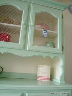 Love the color of this hutch makeover, AND the chicken wire door inserts.