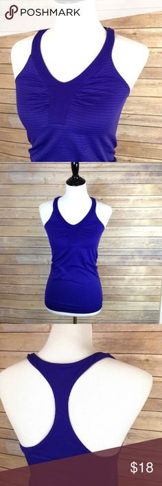 "Under Armour purple spandex workout tank I promise this Under Armour tank is purple! 💜 The straps are textured. EUC! No snags.  APPROX FLAT MEASUREMENTS  25"" ↕️ from top of shoulder strap 14"" ↔️ armpits  SBD10 Under Armour Tops Tank Tops"