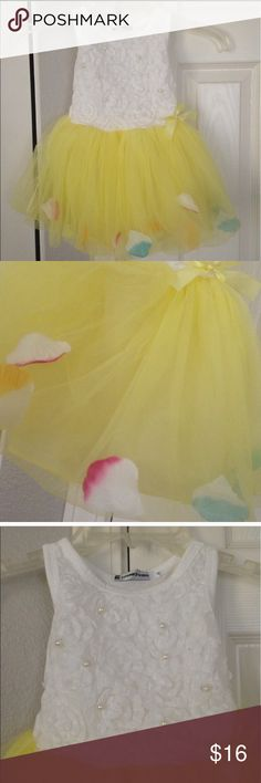 New 6-12 month flower petal tutu dress New with tag. Soft and breathable Cotton fabric on top. Comfortable to touch and wear. Flower petals in the hem, adjust them to one location or spread them all around. Super cute. size: 6-12month Dresses Casual