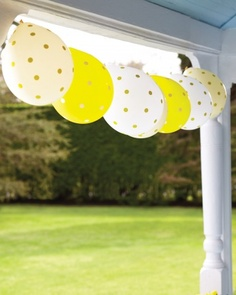Easter Decorations That Pop!  A garland of balloons, dotted with office supply stickers and tied to a length of string, sways in the spring breeze.