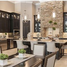 So warm and cozy! Love the statement stone work in the kitchen! By Masterpiece Design Group