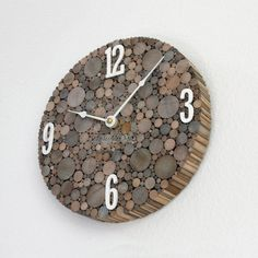 Rustic Wood Wall Clock, available in four sizes: 12, 10, 8 and 6 inches. My clocks are made from birch dowel rods, cut into 1 inch pieces and stained with homemade wood stain. This clock adds a nice, rustic touch to your home décor!