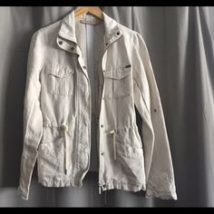 Linen utility jacket Linen material. Military jacket with four front pockets. Zip and snap button front. Collar. Sleeves can be rolled up and held with a snap button. Worn once and washed. Small Jackets & Coats Utility Jackets