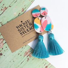 Tassel dangle earrings, Clay and Tassel earrings, Statement Tassel earrings, Art dangles handmade by WickedSisterStudio by WickedSisterStudio on Etsy https://www.etsy.com/au/listing/595330188/tassel-dangle-earrings-clay-and-tassel