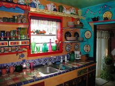 This kitchen is ridiculous and amazing! I want to do a teal and red kitchen with chili peppers and random pops of bright colors :-)