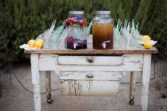 Love this wedding drink table arrangement - straws in glasses ready to go!!