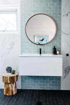 Home Interior Colour blue and marble tile bathroom + bathroom design + floating vanity + round bathroom mirror Bathroom Renos, Laundry In Bathroom, Bathroom Interior, Modern Bathroom, Master Bathroom, Bathroom Ideas, Minimalist Bathroom, Small Bathrooms, Small Bathtub