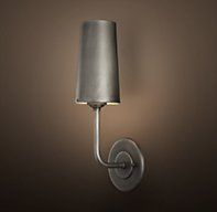 Restoration Hardware's Modern Taper Sconce with Metal Shade:Our contemporary interpretation of a classic sconce elevates light on a single arm and shelters it behind a clean-lined shade.