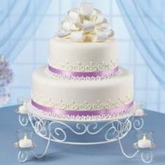Do a cake like this only a little smaller. Use blueberries instead of the little flowers. Do a blueberry filling between layers. Use the blue ribbon I have.