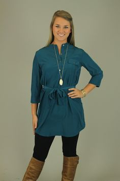 SIMPLY SHIRT DRESS, TEAL...This color is gorgeous!! Where it as a dress now, and a tunic later! The soft silky material looks super expensive. We love the tie waist and the pockets on the front, so trendy! You need this in your closet!!! Lindsay has paired this with our black love-able leggings and our fringe scarf.
