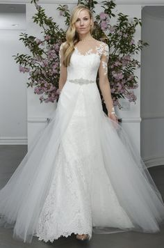 Simply breathtaking wedding gown with a partial overlay skirt and delicate sheer sleeves | Legends Romona Keveza