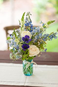 Rustic Blue Wedding Flowers! | Emlily Floral.   Wildflower arrangement in blue Masson jar includes blue delphinium,  snap dragons,  anemones, roses, and tweedia!