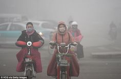 People rode in smog on December 20 in Jinan, Shandong Province. Air quality index (AQI) re...