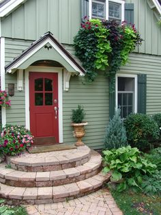 This small home's color scheme is charming - the soft understated light green siding, white trim, and dark green shutters provide the perfect backdrop for the red front door - talk about inviting!  We do exterior painting in the #Bellingham WA area. http://www.northpinepainting.com