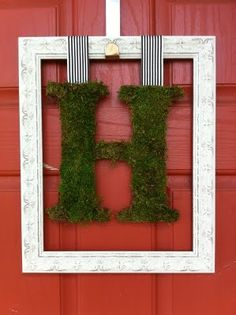 I love the idea of framing the moss letter and hanging it on the front door.  A great way to re-purpose our moss initial after the wedding.