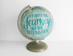 12 Vintage Globe with champagne-colored base and arm. Painted with Its about the journey not the destination in teal blue. 12 wide x 16