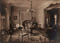 The parlor would have been the nicest room in the house. This article explains its uses...from entertaining to macabre. (Image Source: https://c2.staticflickr.com/2/1351/1339867930_cc17463fc8_b.jpg)